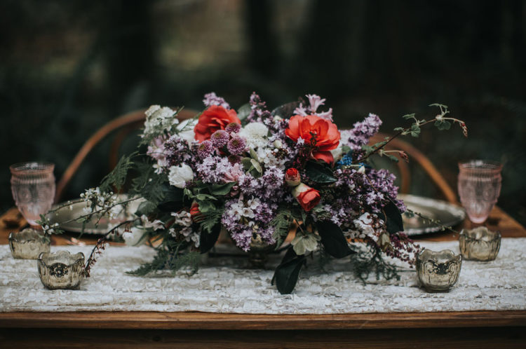 Look at the centerpiece done in shades of purple, red and with white blooms
