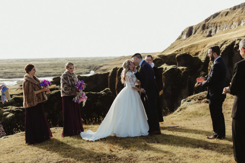 The bridesmaids were wearing purple maxi dresses and brown fur coats, the florals were purple and pink