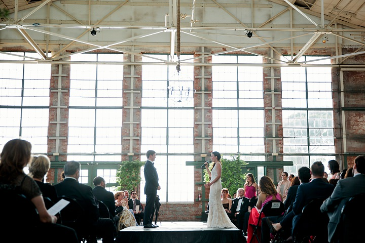 The industrial wedding was softened with greenery