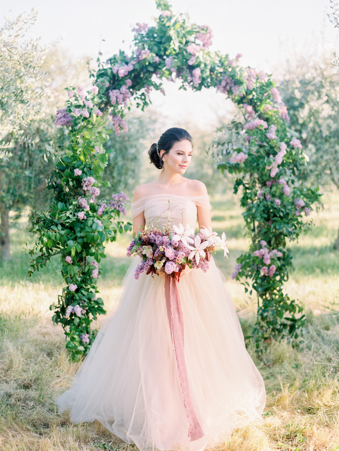 The wedding arch was made of greenery and beautiful lilac, such a beautiful idea for spring
