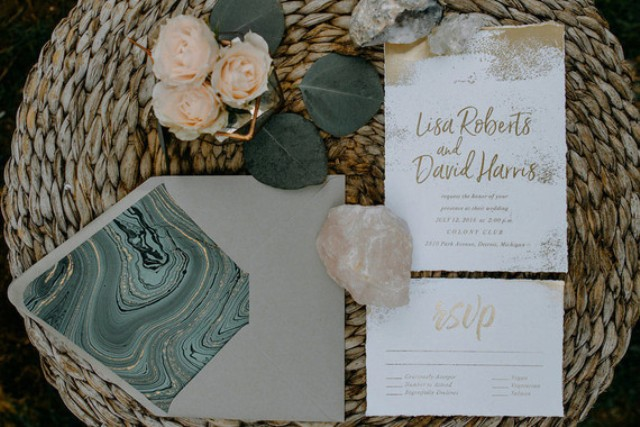The wedding invitation suite was done in green marble and with gold touches