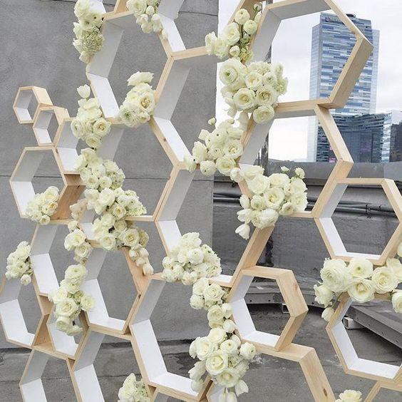 honeycomb wedding backdrop topped with fresh white roses