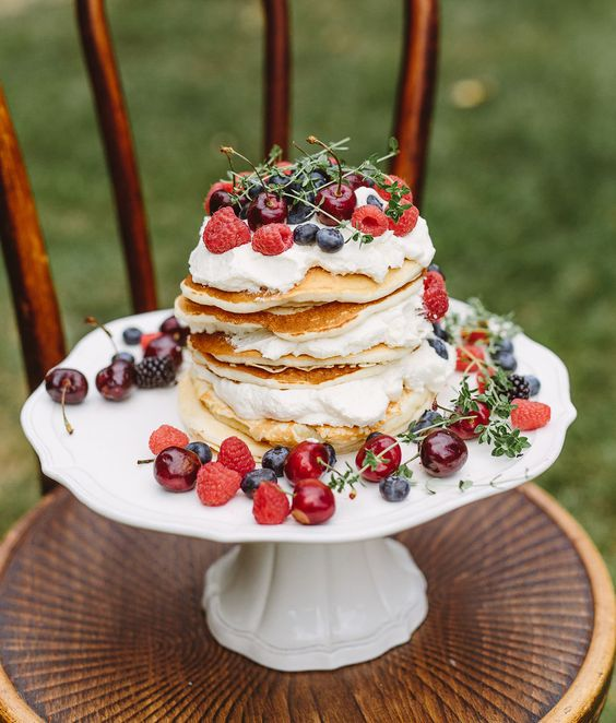 pancake wedding cake with cream and fresh berries