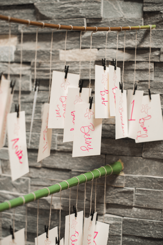 The seating chart was made with handmade cards and bamboo branches