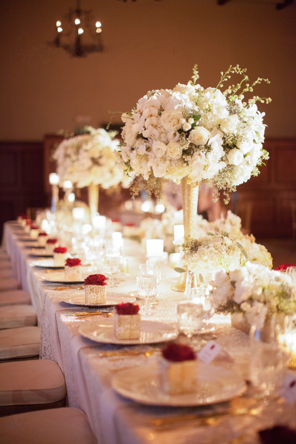 The wedding tablescape was done with white florals and touches of gold for more elegance
