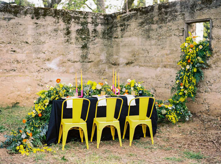 The yellow chairs highlighted the bold colors of the floral garland