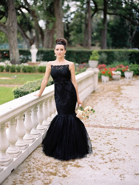 black lace mermaid wedding dress with a tulle tail and thin embellished straps