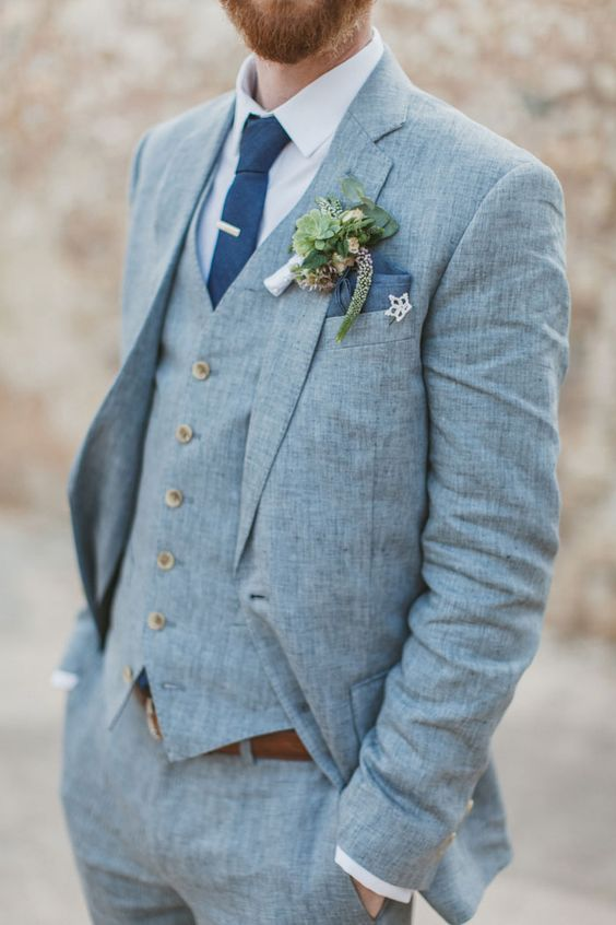 light blue three-piece wedding suit with a white shirt and a blue tie