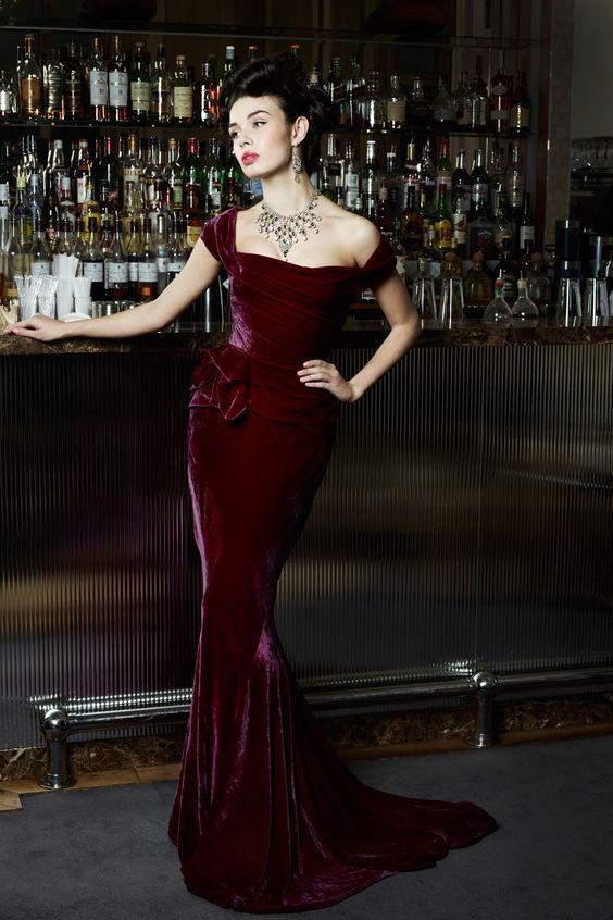 off the shoulder deep purple velvet wedding dress with a mermaid silhouette
