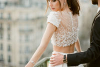 09 I love the beaded crop top with a row of buttons on the back, looks amazing