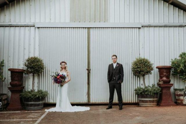 The industrial venue was softened with greenery and florals