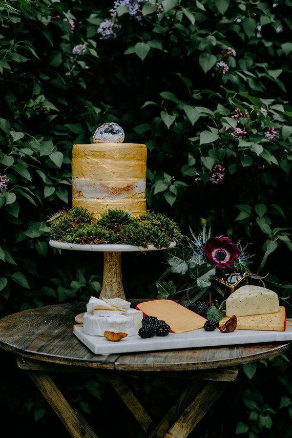 The wedding cake was done in yellow and covered with moss to give it a woodland-inspired look