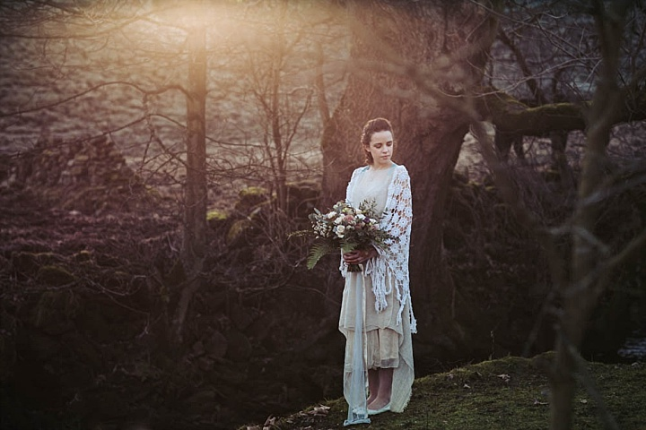 The wedding dress was a sheer handmade one, with a layered skirt and two different coverups - a macrame one and a linen one with a pompom trim