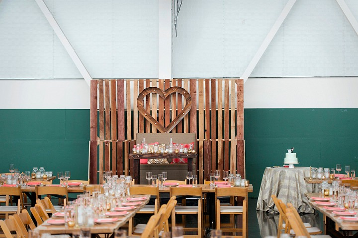 There was made a pallet backdrop with a marquee heart for the couple