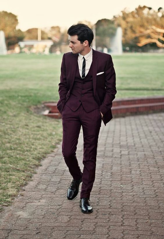 a marsala wedding suit with a thin striped tie and black shoes looks wow
