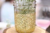 09 a wooden piece with a glittered mason jar and baby's breath for a centerpiece