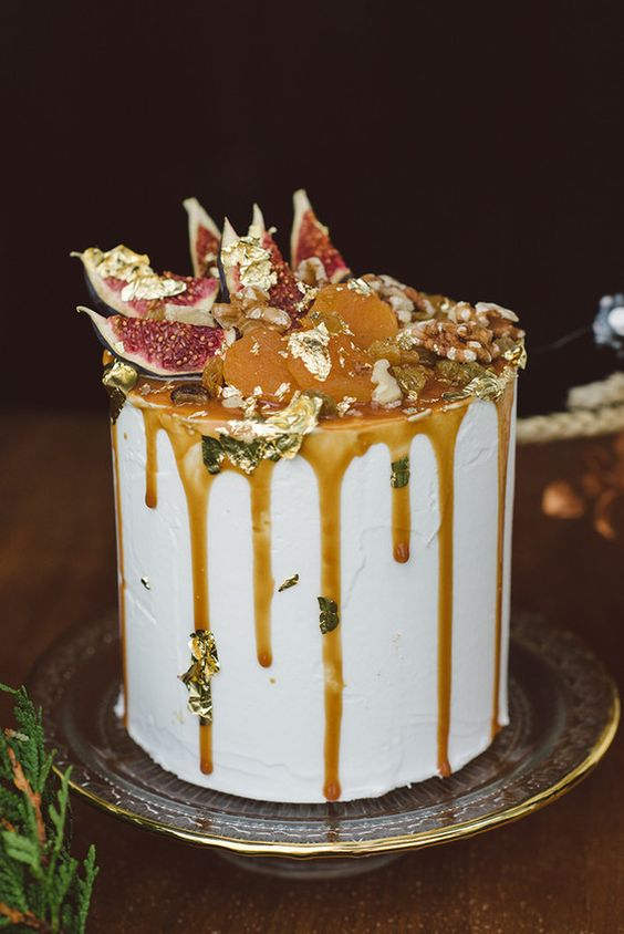 decadent frosted wedding cake with salted caramel drip, gold leaf, figs and dried fruit