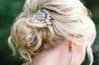 09 messy curly updo for medium length hair with a rhinestone hairpiece