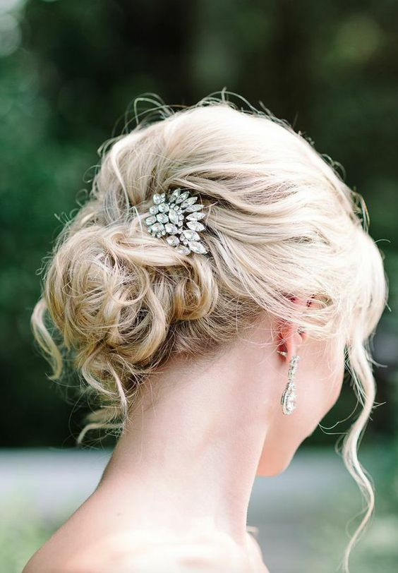 messy curly updo for medium length hair with a rhinestone hairpiece