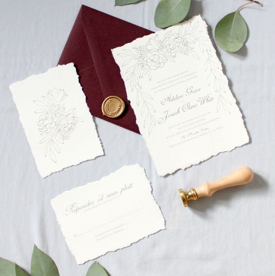 neutral wedding invitations with burgundy envelopes