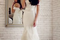 09 off the shoulder mermaid wedding dress with a belt and a feathered skirt
