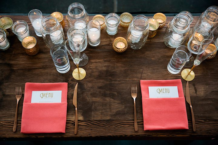 The table settings had touches of gold and coral, lots of candles and no tablecloths