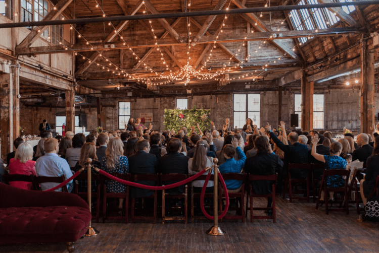 The venue was an old barn filled with lights and decorated with velvet furniture