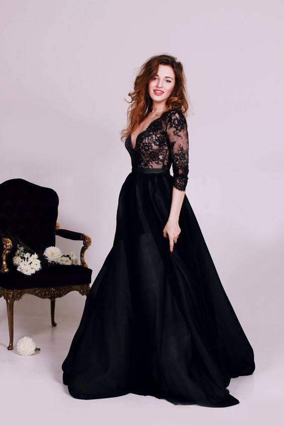 a black lace deep V-neck wedding dress with long sleeves and a plain full skirt
