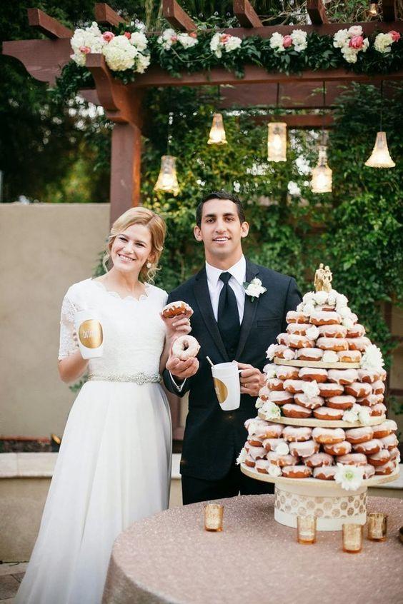 a glazed donut wedding cake is a gorgeous and yummy idea