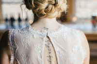 10 braided messy updo with a beaded flower hairpiece