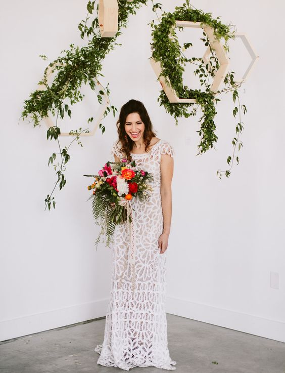hanging honeycombs with lush greenery for an airy wedding backdrop
