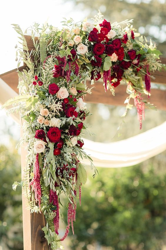 lush greenery, ivory and red roses weddign arch decor