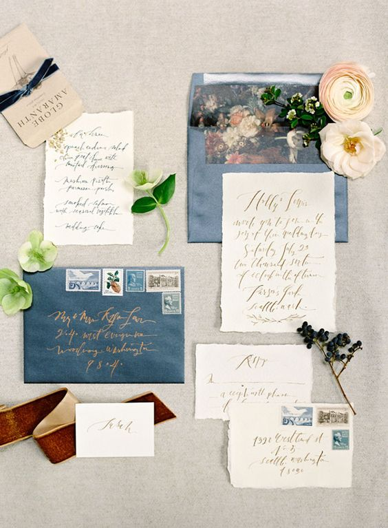 neutral calligraphy invites and blue envelopes with floral lining
