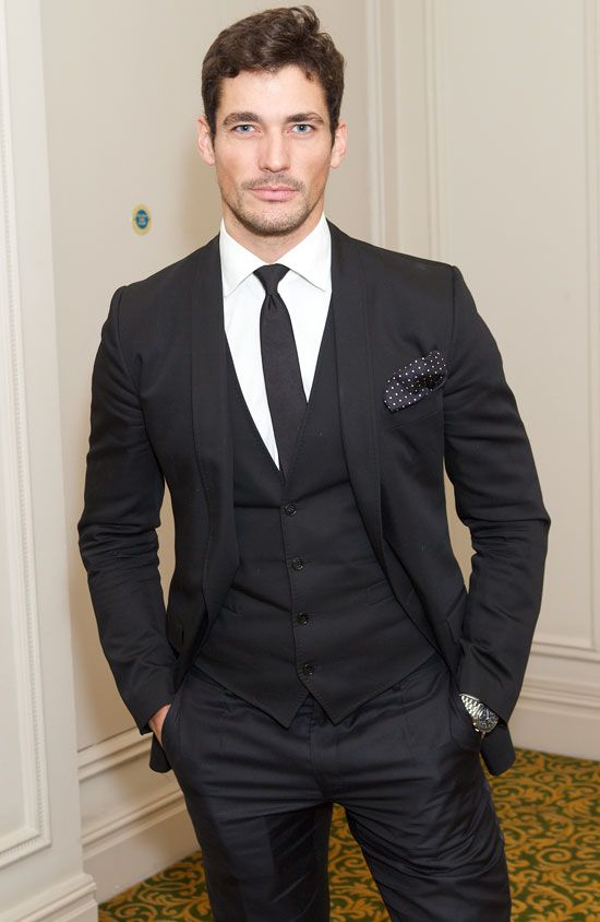 a black three piece suit with a black tie is a classic idea that will suit many themes and styles