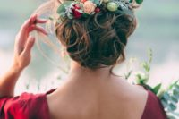11 curly wedding updo topped with a fresh flower and greenery headpiece