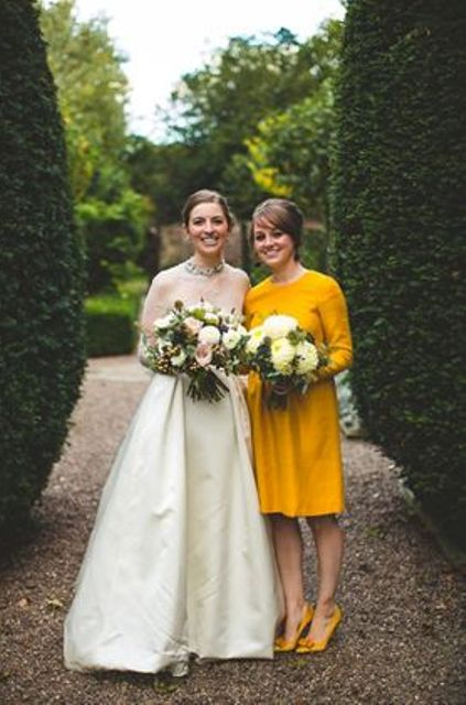 long-sleeve mustard knee bridesmaid's dress and shoes for a retro look