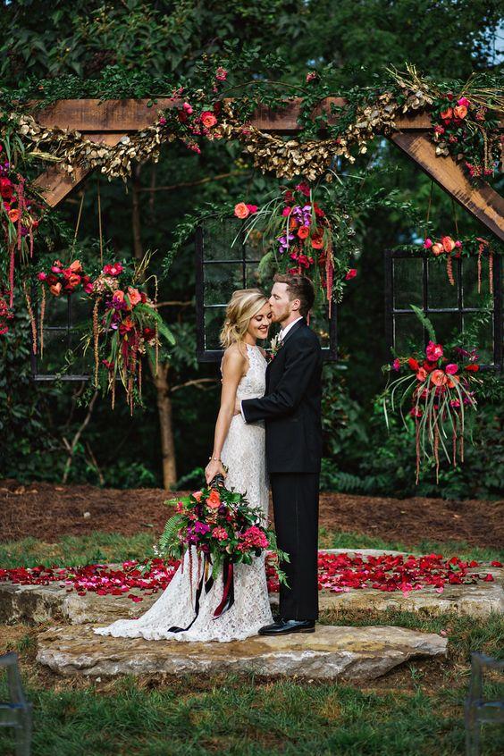 lush berry-hued floral wedding backdrop