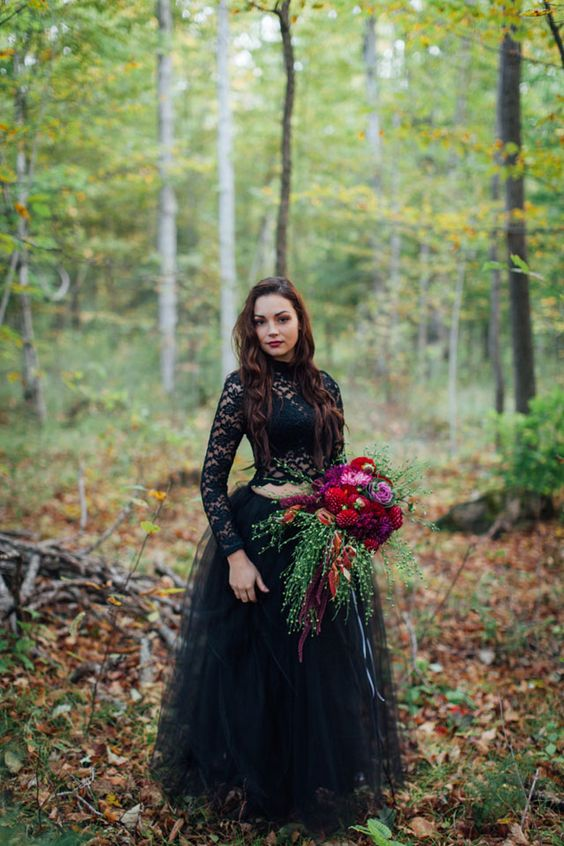 a black wedding separate with a lace top with long sleeves and a tulle layered skirt
