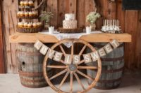 12 a dessert bar on barrels, with a wheel, a burlap banner and wood slices for displaying