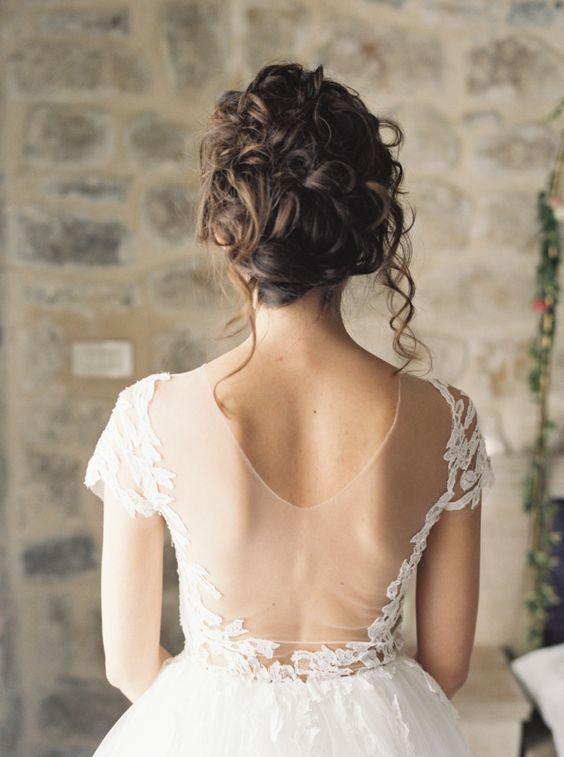 messy curly wedding updo is a natural and chic choice