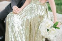 12 strapless gold sequin wedding dress with a draped bodice