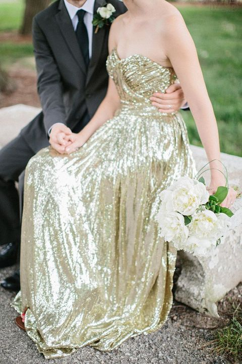 strapless gold sequin wedding dress with a draped bodice