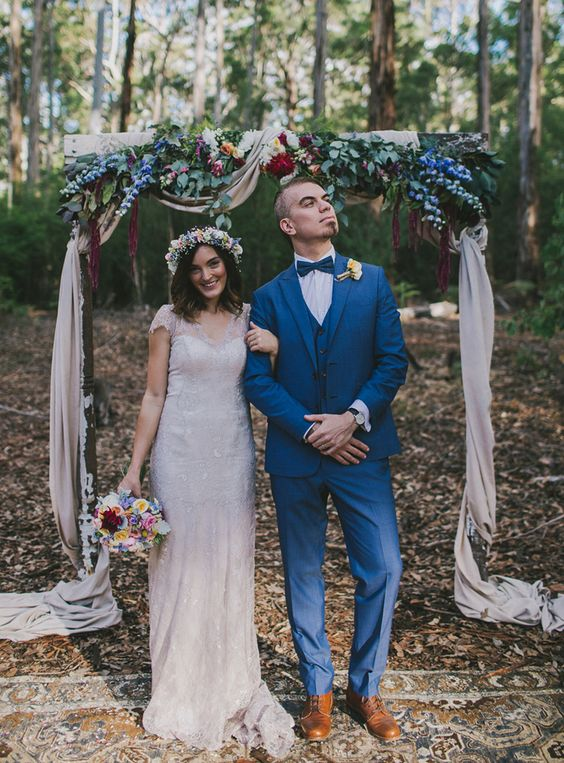 bold blue three piece wedding suit with a blue bow tie and copper shoes