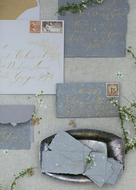 grey raw edge wedding invitations with gold calligraphy