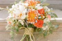 14 a blush and orange wedding bouquet with twine wrapping
