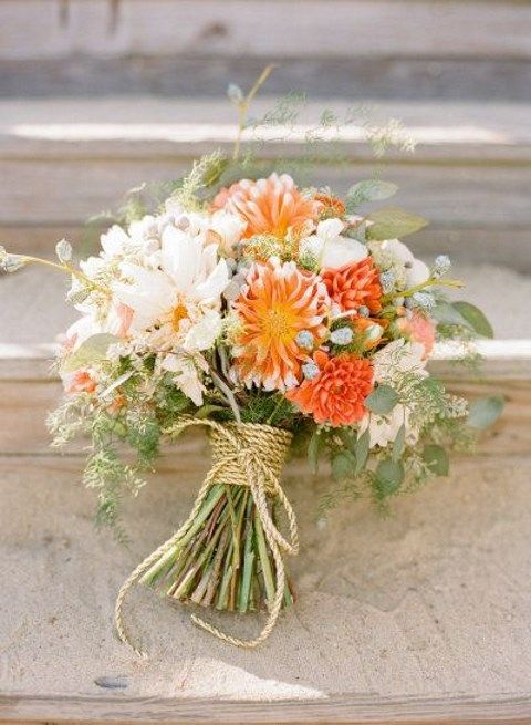 a blush and orange wedding bouquet with twine wrapping