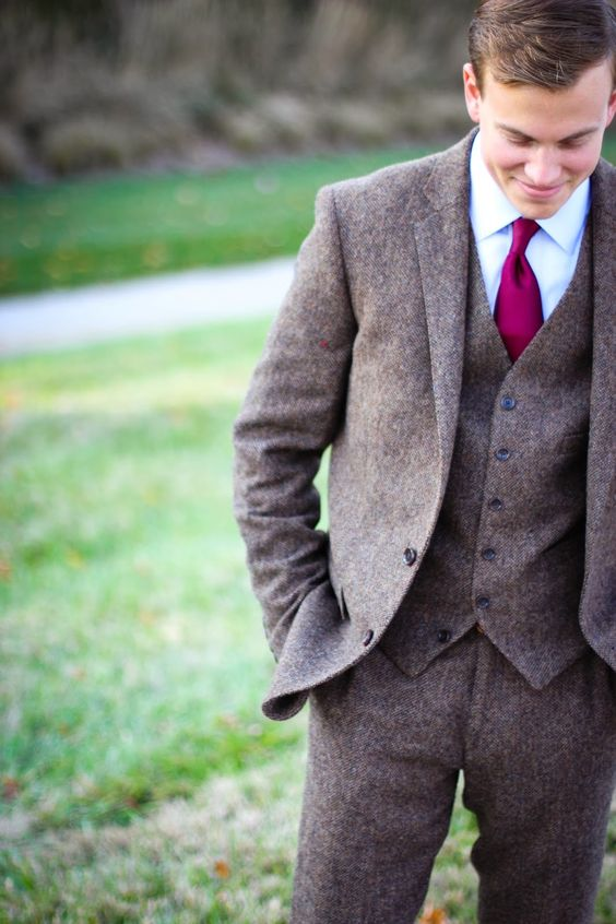 a brown tweed three piece suit with a bold tie is a nice idea for the fall and winter
