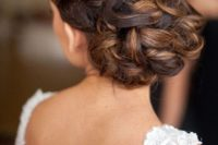 14 braided and twisted low updo with no accessories will fit lots of bridal styles