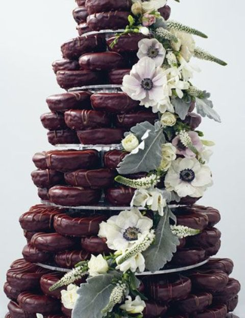 chocolate glaze donut tower with greenery and fresh blooms
