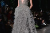 14 dark grey plunging neckline short sleeve wedding dress with a semi sheer bodice and a feather skirt